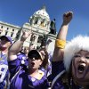 Minnesota Vikings fan Erin Darsow, right, of Burnsville, Minn., attens a rally at the state Capitol in support of a new stadium for the NFL football team, Monday, May 7, 2012, in St. Paul, Minn. Supporters of a new Vikings stadium pleaded for votes in the Minnesota House on Monday, calling it their