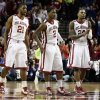 Oklahoma\'s Cameron Clark (21), Steven Pledger (2) and Romero Osby (24) wait at mid court as a teammate shoots free throws to close out he second half as the University of Oklahoma Sooners (OU) defeat the Kansas Jayhawks (KU) 72-66 in NCAA, men\'s college basketball at The Lloyd Noble Center on Saturday, Feb. 9, 2013 in Norman, Okla. Photo by Steve Sisney, The Oklahoman