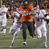 Oklahoma State\'s Jamie Blatnick (50) returns a fumble as he is chased by Oklahoma\'s Roy Finch (22) and Oklahoma\'s Trent Ratterree (47) during the Bedlam college football game between the Oklahoma State University Cowboys (OSU) and the University of Oklahoma Sooners (OU) at Boone Pickens Stadium in Stillwater, Okla., Saturday, Dec. 3, 2011. Photo by Chris Landsberger, The Oklahoman