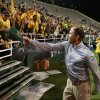 Photo - Baylor coach Art Briles throws his hat to the crowd following an NCAA college football game against West Virginia, Saturday, Oct.  5, 2013, in Waco, Texas. Baylor won 73-42. (AP Photo/Jose Yau)