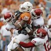 UT\'s Malcolm Brown (28) is taken down by, clockwise from left, Jaydan Bird (55), Frank Alexander (84) and Travis Lewis (12) in the second half during the Red River Rivalry college football game between the University of Oklahoma Sooners (OU) and the University of Texas Longhorns (UT) at the Cotton Bowl in Dallas, Friday, Oct. 7, 2011. OU won, 55-17. Photo by Nate Billings, The Oklahoman