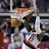 Portland Trail Blazers forward J.J. Hickson scores during the first quarter of an NBA basketball game against the Memphis Grizzlies in Portland, Ore., Wednesday, April 3, 2013.(AP Photo/Don Ryan)