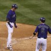 Photo - Colorado Rockies' Troy Tulowitzki (2) celebrates after scoring a run during the fifth inning of a baseball game against the Arizona Diamondbacks  Wednesday, June 4, 2014, in Denver. (AP Photo/Jack Dempsey)