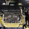 Miami Heat\'s LeBron James (6) shoots over Indiana Pacers\' Paul George (24) during the first half of Game 3 of the NBA Eastern Conference basketball finals in Indianapolis, Sunday, May 26, 2013. At left is Pacers\' Roy Hibbert. (AP Photo/Nam H. Huh)