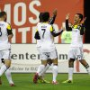 Photo - Columbus Crew's Jairo Arrieta (19) celebrates his goal with Bernardo Anor (7) and Josh Williams (3) during the first half of an MLS soccer game against D.C. United, Saturday, March 8, 2014, in Washington. (AP Photo/Nick Wass)