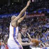 Orlando Magic guard Beno Udrih, right, drives to the basket around Oklahoma City Thunder\'s Derek Fisher, left, during the second quarter of an NBA basketball game in Oklahoma City, Friday, March 15, 2013. (AP Photo/Alonzo Adams)