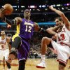 Photo - Los Angeles Lakers center Dwight Howard (12) pushes Chicago Bulls center Joakim Noah (13) away from a rebound during the second half of an NBA basketball game Monday, Jan. 21, 2013, in Chicago. The Bulls won 95-83. (AP Photo/Charles Rex Arbogast)