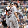 Photo - Detroit Tigers catcher goes out to the mound to confer with starting pitcher Max Scherzer during fourth inning play of a baseball game against the San Diego Padres Sunday, April 13, 2014, in San Diego. (AP Photo/Don Boomer)