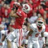 Photo -   Wisconsin wide receiver Jared Abbrederis (4) makes a reception in front of UTEP defensive back Darren Woodard during the first half of an NCAA college football game Saturday, Sept. 22, 2012, in Madison, Wis. (AP Photo/Andy Manis)