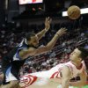 Houston Rockets\' Donatas Motiejunas, right, is fouled by Minnesota Timberwolves\' Derrick Williams, left, in the first half of an NBA basketball game Friday, March 15, 2013, in Houston. (AP Photo/Pat Sullivan)