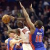 Detroit Pistons center Greg Monroe, right, and forward Kyle Singler, left, guard as Chicago Bulls forward Luol Deng, center, looks to pass during the first half of an NBA basketball game in Chicago on Sunday, March 31, 2013. (AP Photo/Nam Y. Huh)