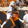 Oklahoma State\'s Brodrick Brown (19) is called for pass interference on Texas\' Mike Davis (1) during a college football game between Oklahoma State University (OSU) and the University of Texas (UT) at Boone Pickens Stadium in Stillwater, Okla., Saturday, Sept. 29, 2012. Photo by Bryan Terry, The Oklahoman