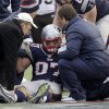 Photo - New England Patriots tight end Rob Gronkowski, center, is helped after being injured following a catch against the Cleveland Browns in the third quarter of an NFL football game on Sunday, Dec. 8, 2013, in Foxborough, Mass. (AP Photo/Steven Senne)