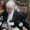 FILE - In this April 7, 2010 file photo, former Pennsylvania state Sen. Jane Orie, left, her sisters Janine Orie, right, and Pennsylvania Supreme Court Justice Joan Orie Melvin, center right, listen as their brother Jack Orie, center, reads a statement to the press outside a magistrate\'s office in Pittsburgh. With the conviction of Melvin and Janine Orie on Thursday, Feb. 21, 2013, and Jane Orie\'s 2012 conviction, all three sisters were found guilty in campaign related in campaign corruption crimes. (AP Photo/Keith Srakocic, File)