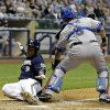 Texas Rangers catcher Geovany Soto (8) tags out Milwaukee Brewers\' Jean Segura (9) at home during the third inning of a baseball game Wednesday, May 8, 2013, in Milwaukee. Segura tried to score from second on a hit by Aramis Ramirez. (AP Photo/Morry Gash)