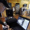 Photo - In this Sept. 4, 2013 photo, explorer Barry Clifford, left, reviews an X-ray image of a concretion showing a cannon ball and coins that diver and conservator Chris Macort, right, had recorded in Brewster, Mass. The concretion is some of the new treasure recovered around the wreck of the Whydah, a pirate ship that sank during a ferocious storm off Cape Cod in 1717. Clifford located the Whydah site in 1984 and has since documented 200,000 artifacts. He only recently got indications there may be far more coins than the roughly 12,000 he's already documented. (AP Photo/Cape Cod Times, Merrily Cassidy)  MANDATORY CREDIT. INTERNET OUT. MAGS OUT. TV OUT. NO ARCHIVING WITHOUT PERMISSION. NO SALES.