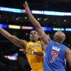 Los Angeles Lakers forward Antawn Jamison (4) gets a shot off over Los Angeles Clippers forward Lamar Odom (7) in the first half of an NBA basketball game, Friday, Nov. 2, 2012, in Los Angeles.(AP Photo/Gus Ruelas)