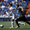 Photo - Real Madrid's Gareth Bale, left, duels for the ball with Espanyol's Javier Lopez during a Spanish La Liga soccer match at the Santiago Bernabeu stadium  in Madrid, Spain, Saturday, May 17, 2014 . (AP Photo/Daniel Ochoa de Olza)