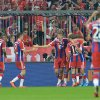 Photo - Bayern's players celebrate after scoring during the  soccer match between FC Bayern Munich and VfL Wolfsburg in the Allianz Arena in Munich, Germany, on Friday, Aug. 22, 2014. (AP Photo/Kerstin Joensson)