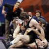 Oklahoma State\'s Chris Perry, bottom, wrestles Iowa\'s Michael Evans in a semifinal match at 174 pounds during the 2014 NCAA Div. I Wrestling Championships at Chesapeake Energy Arena in Oklahoma City, Friday, March 21, 2014. Photo by Nate Billings, The Oklahoman