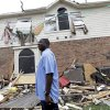 Charles Paige stands amongst tornado debris as he surveys the damage to his home Wednesday, April 4, 2012, in Forney, Texas. The mayor of Forney, Texas, says it\'s
