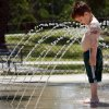 Jimmie Northrup, 3, plays at the splash pool in Andrews Park in Norman, Oklahoma on Wednesday, May 21, 2008. BY STEVE SISNEY, THE OKLAHOMAN