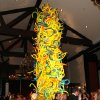 Photo -  25-foot tall balloon tower in the Great Hall of Oklahoma City Golf & Country Club at the Renaissance Ball. The balloon feature was a replica of the colorful Chihuly glass tower in the front window of the Oklahoma City Art Museum.