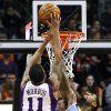 Denver Nuggets\' Wilson Chandler (21) blocks the shot of Phoenix Suns\' Markieff Morris (11) in the first half of an NBA basketball game, Monday, Nov. 12, 2012, in Phoenix. (AP Photo/Ross D. Franklin)