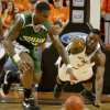 Texas A&M-Corpus Christi\'s Justin Reynolds, left, and OSU\'s Obi Muonelo during the college basketball game between Oklahoma State University and Texas A&M-Corpus Christi at Gallagher-Iba Arena in Stillwater, Okla., Wednesday, December 5, 2007. By Matt Strasen, The Oklahoman