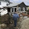 Michael Martin looks at his neighbor\'s house that was heavily damaged by surge from Superstorm Sandy on Cedar Bonnet Island, N.J., Saturday, Nov. 3, 2012. (AP Photo/Patrick Semansky)