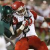 Lawton\'s Tristan Gooden fights off Edmond Santa Fe\'s Khari Harding during their high school football game at Wantland Stadium in Edmond, Okla., Thursday, October 11, 2012. Photo by Bryan Terry, The Oklahoman