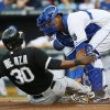 Chicago White Sox\'s Alejandro De Aza (30) is tagged out by Kansas City Royals catcher Salvador Perez, right, during the first inning of a baseball game at Kauffman Stadium in Kansas City, Mo., Friday, June 21, 2013. (AP Photo/Orlin Wagner)