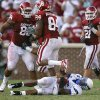 Oklahoma\'s Adrian Taylor (86) and Frank Alexander (84) celebrate after a sack on Air Force\'s Tim Jefferson (7) during the second half of the college football game between the University of Oklahoma Sooners (OU) and the Air Force Falcons at the Gaylord Family - Memorial Stadium on Saturday, Sept. 18, 2010, in Norman, Okla. Photo by Chris Landsberger, The Oklahoman