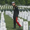 England\'s Prince Harry visits Section 60 at Arlington National Cemetery, Friday, May 10, 2013. The British soldier-prince is spending most of his week in the U.S. honoring the wounded and the dead of war. (AP Photo/Charles Dharapak, Pool)