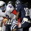 Millwood\'s Marc Robinson pushes Star Spencer\'s Milon Smith into the end zone as he scores a touchdown during a high school football game at Star Spencer in Oklahoma City, Friday, September 2, 2011. Photo by Bryan Terry, The Oklahoman