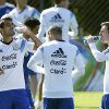 Photo - Argentina's Lionel Messi, right, drinks Powerade as teammate Augusto Fernandez, left, drinks water during a training session in Vespasiano, near Belo Horizonte, Brazil, Friday, June, 13, 2014. Argentina will play in group F of the Brazil 2014 soccer World Cup. (AP Photo/Victor R. Caivano)