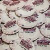 Photo - Buttons are being worn in support of those with breast cancer during the University of Central Oklahoma