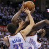 Oklahoma City\'s Serge Ibaka (9) fouls Memphis\' Zach Randolph (50) as Oklahoma City\'s Kevin Martin (23) helps defend during Game 5 in the second round of the NBA playoffs between the Oklahoma City Thunder and the Memphis Grizzlies at Chesapeake Energy Arena in Oklahoma City, Wednesday, May 15, 2013. Photo by Bryan Terry, The Oklahoman
