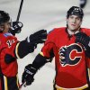 Photo - Calgary Flames' Mike Cammalleri, right, celebrates his goal with Mikael Backlund, from Sweden, during the first period of an NHL hockey game against the Anaheim Ducks in Calgary, Alberta, Wednesday, March 12, 2014. (AP Photo/The Canadian Press, Jeff McIntosh)