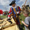 John Keller, portraying Wolfgang Von Sachsenhausen and dressed in a Swiss Guard Uniform, shows Gabriel Reeve, 5, early black powder weapons during the Medieval Fair on Saturday, March 31, 2012, in Norman, Okla. Photo by Steve Sisney, The Oklahoman