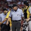 Pittsburgh Pirates catcher Rod Barajas, right, walks off the field after being ejected from a baseball game by home plate umpire Angel Campos, left, as Pirates manager Clint Hurdle, second from left argues with Campos, while umpire crew chief Dale Scott, second from right, stands in the middle during the second inning of the Pirates\' baseball game against the St. Louis Cardinals on Wednesday, May 2, 2012, in St. Louis. Hurdle was also thrown out of the game. (AP Photo/Jeff Roberson)