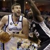 Photo - Memphis Grizzlies' Marc Gasol (33), of Spain, takes the ball around San Antonio Spurs' DeJuan Blair during the first half of an NBA basketball game in Memphis, Tenn., Monday, April 1, 2013. (AP Photo/Danny Johnston)