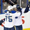 St. Louis Blues\' Ryan Reaves (75) and Maxim Lapierre (40) celebrate a goal against the Edmonton Oilers during second period NHL hockey action in Edmonton, Canada, Tuesday, Jan. 7, 2014. (AP Photo/The Canadian Press, Jason Franson)