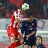 Olympiakos\' Kostas Manolas, left, fights for the ball with Arsenal\'s Marouane Chamakh during their group B Champions League soccer match in the port of Piraeus, near Athens, Tuesday, Dec. 4, 2012. (AP Photo/Thanassis Stavrakis)