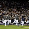 Photo -   The Detroit Tigers rush the field after the team won the American League championship series against the New York Yankees in Game 4, Thursday, Oct. 18, 2012, in Detroit. The Tigers, who won 8-1, move on to the World Series. (AP Photo/Paul Sancya)