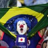 A Japanese fan cheers before the start of the group C World Cup soccer match between Ivory Coast and Japan at the Arena Pernambuco in Recife, Brazil, Saturday, June 14, 2014. (AP Photo/Petr David Josek)