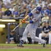 Photo - New York Mets' Lucas Duda hits a two-run home run against the Milwaukee Brewers during the sixth inning of a baseball game Sunday, July 27, 2014, in Milwaukee. (AP Photo/Jeffrey Phelps)
