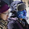 Women are bundled up as they walk in cold weather, Sunday, Feb. 14, 2016, in the Queens borough of New York. Bitter temperatures and biting winds had much of the northeastern United States bundling up this weekend. (AP Photo/Mark Lennihan)