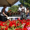 Lisa Johnson, 46, inspects some flowers Saturday with her niece Kaelie Robinson, 7, Saturday at the Edmond Farmers Market. Photo by Ashley McKee, The Oklahoman