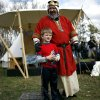 King Henry I, played by George Williams of Oklahoma City, poses with Draven Pierce, age 7, of Oklahoma City after Draven was knighted during a brief ceremony at the 34th annual Medieval Fair at Reaves Park in Norman on Sunday, March 28, 2010. Photo by John Clanton, The Oklahoman